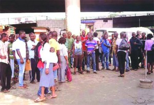 •Stranded commuters waiting to board buse at Obalende this morning