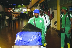 L-R: Super Eagles' midfielder, Ogenyi Onazi, Team Coordinator, Emmanuel Attah and goalkeeper Austin Ejide arrive Jomo Kenyatta Airport early today for the 2014 World Cup qualifier against Harambee Stars in Nairobi, Kenya Wednesday.
