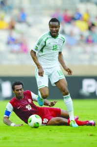ON THE MOVE...Super Eagles of Nigeria midfielder, John Obi Mikel (top) drives the ball past Tahiti's defender, Nicolas Vallar during their FIFA Confederations Cup Brazil 2013 Group B match, at the Mineirao Stadium in Belo Horizonte on 17 June, 2013. Nigeria won 6-1.