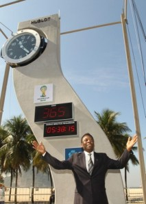 Brazil's football legend, Pelé, poses after the ceremony of the unveiling clock designed by the late star architect Oscar Niemeyer to mark the one-year countdown to next year's World Cup  in Copacabana Beach, Rio de Janeiro, Brazil on June 12, 2013.