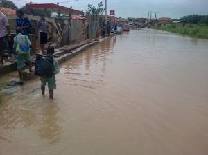 •School children wading through the murky water