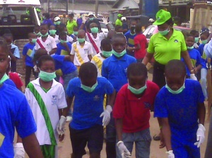 •Students of  Santa Maria Private School Mushin, Lagos with their  head teacher, Mrs Lucy Ikeh during a street cleaning exercise in their area