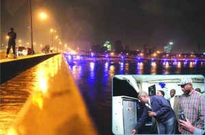 •Carter Bridge from Idumota to Iddo, Ijora Olopa, Adeniji-Adele, Ebute Ero and Offin brightly lit last night shortly after the brief switching on ceremony of the Public Light infrastructure performed by the Lagos State Governor, Mr. Babatunde Fashola (SAN) on Sunday, June 30, 2013. Inset: Lagos State Governor, Mr. Babatunde Fashola SAN (2nd left) switching on the lights.