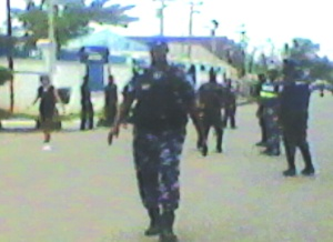 Policemen trying to restore order today, before soldiers took over
