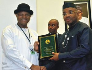 Governor Udom Emmanuel of Akwa Ibom State (right) presenting a memento to the Coordinator, Presidential Amnesty Programme, Brigadier Gen. Paul Boro (rtd.) (left), during a courtesy call on the Governor at Government House, Uyo.