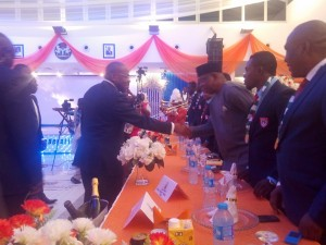 Gov. Emmanuel in a handshake with the coach