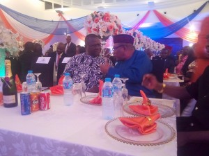 The governor interacting with a dignitary at the event
