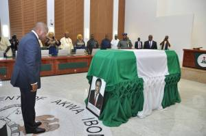 Akwa Ibom State Governor, Mr Udom Emmanual paying tribute to former Governor of the Old Cross River State, Late Chief Donald Dick Etiebiet, OFR, during a special farewell Executive Council Session held at the State Council Chambers, Government House, Uyo. Pix2 Akwa Ibom State Governor, Mr Udom Emmanual, his Deputy, Mr Mosses Ekpo and Members of the State Executive Council during a specialValedictory Executive Council Session held in honour of the former Governor of Cross River State, Late Chief Donald Dick Etiebiet, at Executive Council Chambers, Government House, Uyo. Pix3 Akwa Ibom State Governor, Mr Udom Emmanual (middle) in a handshake with the family Head Atuekong Don Etiebiet, during a Valedictory Executive Council Session held in honour of former Governor of Cross River State, Late Chief Donald Dick Etiebiet, at Executive Council Chambers, Government House, Uyo. Pix4 Akwa Ibom State Governor, Mr Udom Emmanual in an handshake with Senator Hellen Esuene, at the funeral Service held in honour of the former Governor of Cross River State, Late Chief Donald Dick Etiebiet, held at Ikot Ekpuk, Oruk Anam Local Government Area. Pix5 L-R : Akwa Ibom State Governor, Mr Udom Emmanual and wife Martha (middle), Deputy Governor, Mr Mosses Ekpo, Deputy Governor Cross River State, Prof. Ivara Esu, (extreme right) Speaker State House Of Assembly, Hon . Aniekan Uko and State Chief Judge, Justice Stephen Okon, during the funeral Service of former Cross River State Governor, Late Chief Donald Dick Etiebiet, at Ikot Ekpuk, Oruk Anam Local Government Area.
