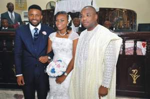 Gov. Udom Emmanuel with the couple at the wedding