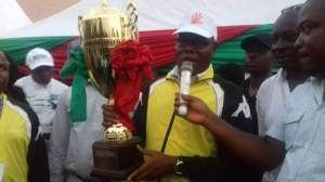 The Honourable Commissioner for Finance, Akparawa Akan Okon, presenting the trophy to the winner