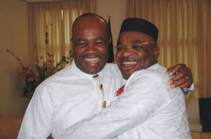 Sen. Akpabio in a warm embrace with Gov. Udom