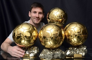 Lionel Messi with his  Ballon d'Or award