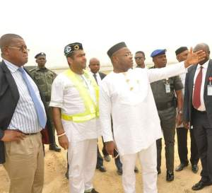 Governor Udom Emmanuel with the Commissioner for Special Duties, Engr. Etido Inyang (left)