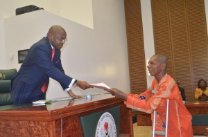 L-R : Akwa Ibom State Governor, Mr Udom Emmanuel (left), presenting a Letter of Appointment to a Physically Challenged Person, Mr Monday Udo Ukanidem of Ikot Udoawan in Obot Akara Local Government Area at Executive Council Chambers,