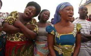 Women weeping in Elele, Rivers State, over a 9-year-old raped to the death by unidentified persons