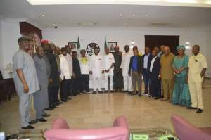 Gov Udom Emmanuel (middle left), Hon Onofiok Luke (middle right) with Akwa Ibom State House of Assembly members during the solidarity visit to the Governor at Government House, Uyo