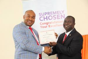 Transition Committee Chairman, Abak Local Government, Hon. Emmanuel Udosen receiving his Dakkada Ambassador certificate from Mr Sam Edoho, Senior Special Assistant to the Governor, Directorate of Marketing & Brand Management, Office of the Governor.