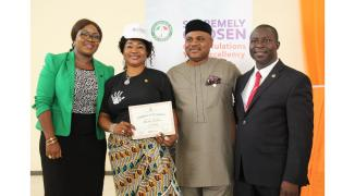 Mrs. Maureen Umanah receiving her Dakkada Ambassador certificate flanked by her husband Mr Aniekan Umanah Commissioner for Information, and Management of the Directorate of Marketing & Brand Management, Office of the Governor., Mr Sam Edoho and Mrs Lydia Udoh