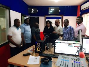 Mr Samuel Akpan, MD, Inspiration 105.9 FM (2nd left); Mr Uwemedimoh Umanah (3rd left); Mrs Meflyn Anwana (middle); Mr Essien Ndueso (3rd right) and Mr Joseph Okon (2nd right) at the studio