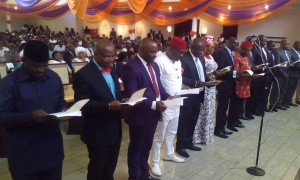 A cross section of the newly sworn-in Council Chairmen taking the oath of office at the Banquet Hall, Government House, Uyo.