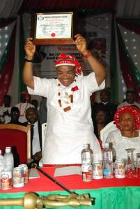 Akparawa Udom Emmanuel displaying his certificate