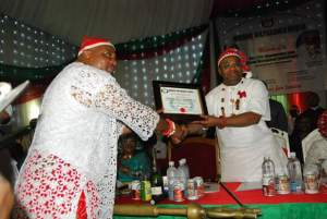 Udom Emmanuel (right) receiving a membership Certificate from the International President Mboho Mkparawa Ibibio, Akparawa Monday Etukakpan, during his induction as member of the Socio-cultural Organisation at Mboho Mkparawa Ibibio International Secretariat, Udo Udoma Avenue, Uyo.