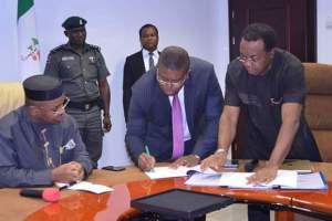 Engr Etido Inyang signing the MoU