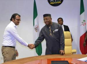 Gov Udom Emmanuel in a handshake with Patrick Adiel of the Ashdene Group