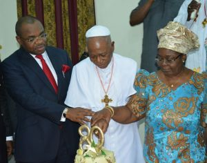 Gov Udom Emmanuel (left) cutting the cake with the Prelate Emeritus, His Eminence, Dr Sunday Mbang