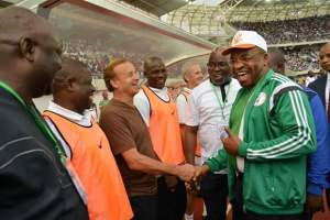 Gov Udom Emmanuel engaging in a handshake with the NFF crew after the match