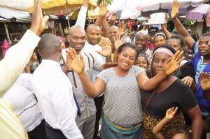 The market women and traders with Special Assistants to the Governor at Akpan Andem market