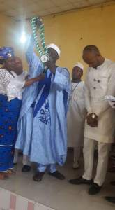 Prince (Alhaji) Haruna Yusuf presenting an award to the Governor's aide